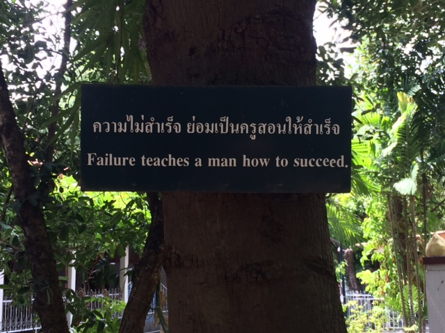 Sign on tree in Thai and English: Failure Teaches A (Hu)man To Succeed